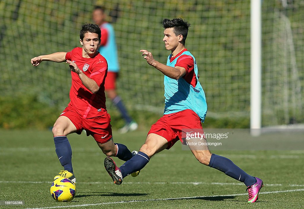 Alfredo Morales (light blue jersey) makes a pass against Connor Lade during the U.S. Men's Soccer Team training session at the Home Depot Center on January 17, 2013 in Carson, California.