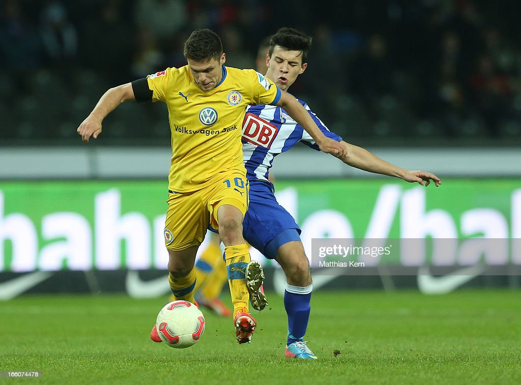 Alfredo Morales (R) of Berlin battles for the ball with Mirko Boland (L) of Braunschweig during the Second Bundesliga match between Hertha BSC Berlin and Eintracht Braunschweig at Olympic stadium on April 8, 2013 in Berlin, Germany.