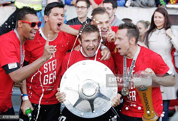 Alfredo Morales of FC Ingolstadt and team mates celebrate after victory in the 2 Bundesliga match between FC Ingolstadt and RB Leipzig at Audi...