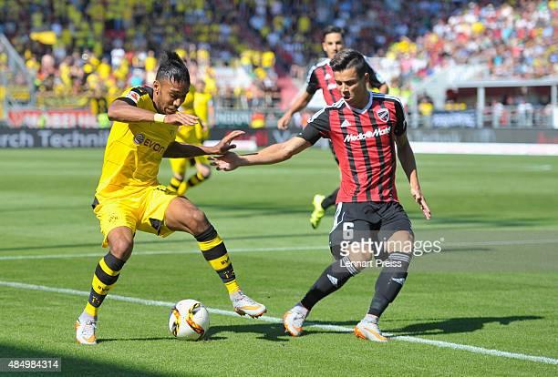Alfredo Morales of FC Ingolstadt challenges PierreEmerick Aubameyang of Borussia Dortmund during the Bundesliga match between FC Ingolstadt and...