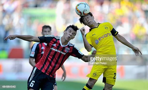 Alfredo Morales of FC Ingolstadt challenges Shinji Kagawa of Borussia Dortmund during the Bundesliga match between FC Ingolstadt and Borussia...