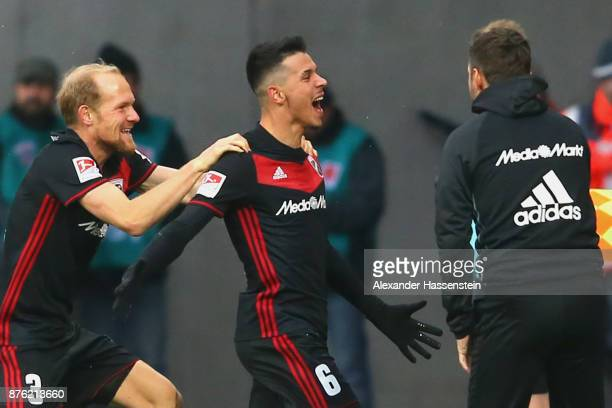 Alfredo Morales of Ingolstadt celebrates scoring the opening goal with his team mate Tobias Levels and head coach Stefan Leitl during the Second...