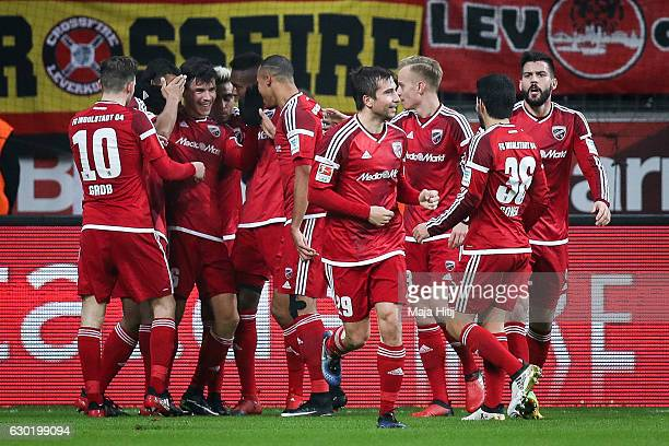 Alfredo Morales of Ingolstadt celebrates with his teammates after scoring his team's first goal to make it 01 during the Bundesliga match between...