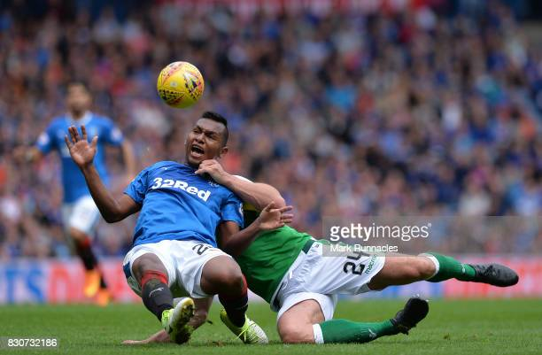 Alfredo Morelos of Rangers is roughly tackled by Darren McGregor of Hibernian during the Ladbrokes Scottish Premiership match between Rangers and...