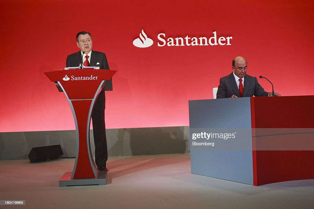 Alfredo Saenz, chief executive officer of Banco Santander SA, left, speaks while Emilio Botin, chairman of Banco Santander SA, listens during a news conference in Madrid, Spain, on Thursday, Jan. 31, 2013. Banco Santander SA posted a fourth-quarter profit that missed analyst estimates as Spain's biggest lender set aside money for further loan losses in its home market and earnings slumped in Brazil and Britain. Photographer: Angel Navarrete/Bloomberg via Getty Images