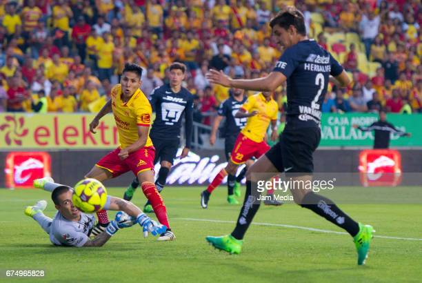 Alfredo Saldivar goalkeeper of Pumas fails to stop a shot by Raul Ruidiaz of Morelia aduring the 16th round match between Morelia and Pumas as part...