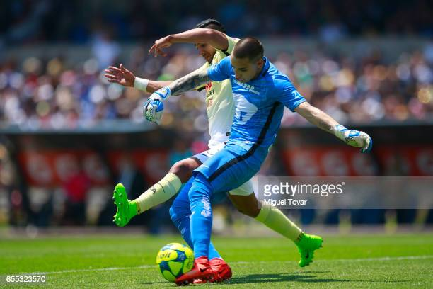 Alfredo Saldivar of Pumas fights for the ball with Cecilio Dominguez of America during the 11st round match between Pumas UNAM and America as par of...