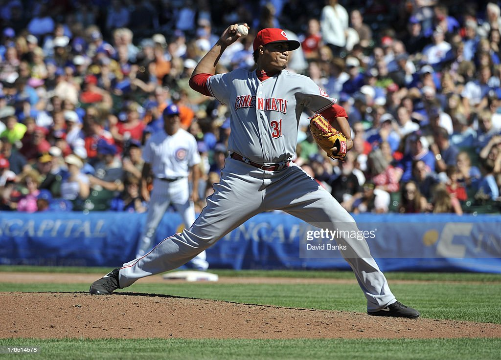<a gi-track='captionPersonalityLinkClicked' href=/galleries/search?phrase=Alfredo+Simon&family=editorial&specificpeople=2530426 ng-click='$event.stopPropagation()'>Alfredo Simon</a> #31 of the Cincinnati Reds pitches against the Chicago Cubs during the eighth inning on August 14, 2013 at Wrigley Field in Chicago, Illinois. The Cincinnati Reds defeated the Chicago Cubs 5-0.
