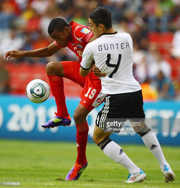 Alfredo Stephens of Panama is tackled by Koray Guenter of Germany during the Group E FIFA U17 World Cup match between Panama and Germany at the...