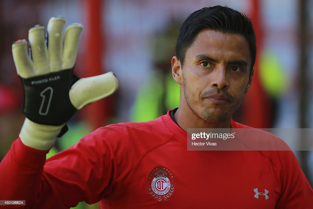 <a gi-track='captionPersonalityLinkClicked' href=/galleries/search?phrase=Alfredo+Talavera&family=editorial&specificpeople=697019 ng-click='$event.stopPropagation()'>Alfredo Talavera</a>, goalkeeper of Toluca, greets during a match between Toluca and Morelia as part of 1st round Apertura 2014 Liga MX at Nemesio Diez Stadium on July 20, 2014 in Toluca, Mexico.