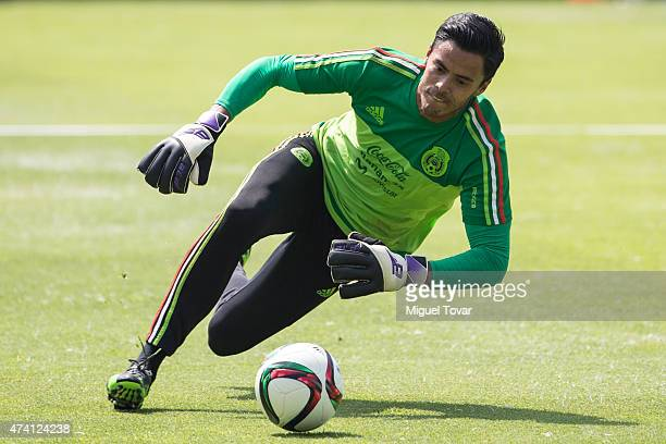 Alfredo Talavera of Mexico dives for the ball during a National Team training session at CAR on May 20 2015 in Mexico City Mexico