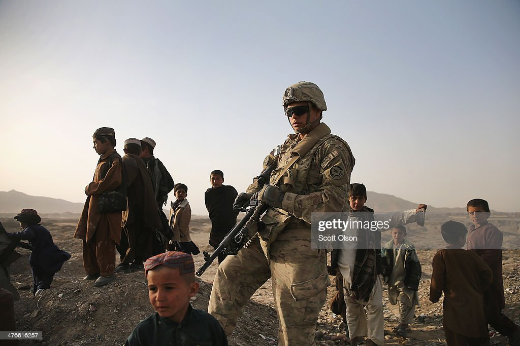 Alfredo Vigil II from Woodlake, California with the U.S. Army's 4th squadron 2d Cavalry Regiment patrols through a Kuchi village on March 3, 2014 near Kandahar, Afghanistan. Kuchis are Afghan Pashtun nomads. President Obama recently ordered the Pentagon to begin contingency planning for a pullout from Afghanistan by the end of 2014 if Afghanistan President Hamid Karzai or his successor refuses to sign the Bilateral Security Agreement.