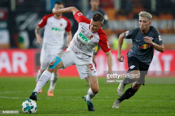 Alfreo Finnbogason of Augsburg and Kevin Kampl of Leipzig during the Bundesliga match between FC Augsburg and RB Leipzig at WWKArena on September 19...