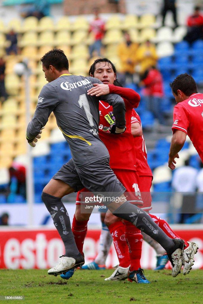 Alfreto Talavera (L) of Toluca celebrates score a goal against Puebla during a match as part of Apertura 2013 Liga MX at Cuauhtemoc Stadium on september 14, 2013 in Puebla, Mexico.