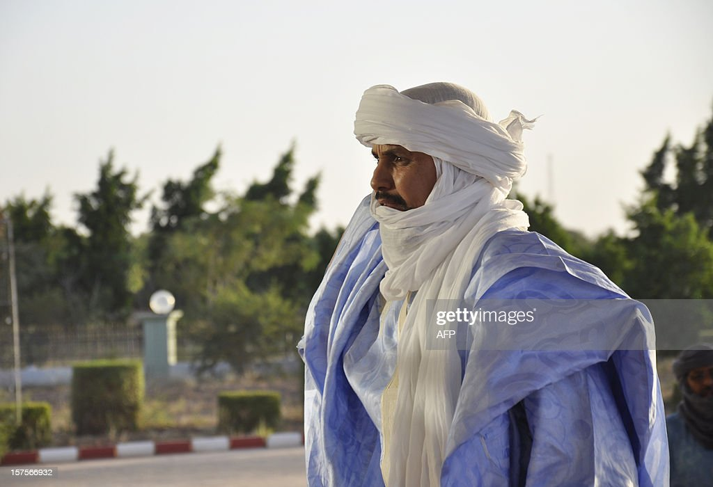Algabass Ag Intalla, leader of the Ansar Dine delegation, arrives to attend a mediation meeting with members of the Malian government and the Azawad National Liberation Movement (MNLA) Tuareg rebellion, hosted by the Burkina Faso President, in Ouagadougou, on December 4, 2012. Delegations from the Malian government and two rebel groups from the country's vast north held their first talks Tuesday to seek an end to the crisis that has split the west African the country in two. Burkina Faso President Blaise Compaore, west Africa's top mediator for the crisis, hosted the meeting in Ouagadougou, and brought together a Malian government delegation with representatives of Ansar Dine (Defenders of the Faith), one of the Al-Qaeda-linked Islamist groups occupying the north, and the Azawad National Liberation Movement (MNLA), which is fighting for an independent homeland for the Tuareg people. AFP PHOTO / AHMED OUOBA