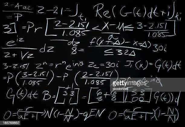 Algebra Math Problem on a Black Chalkboard