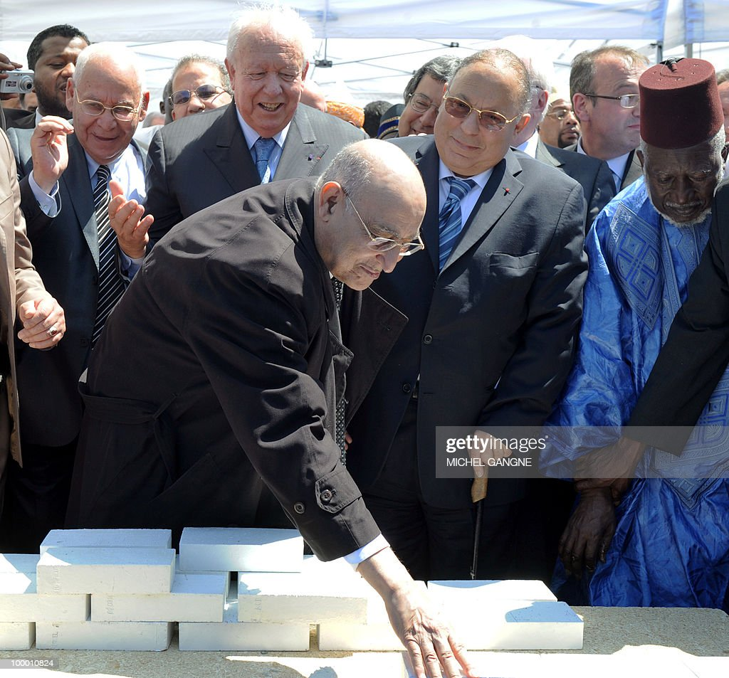 Algeria ambassador in France Mayssoun Sbih (C) stands with the mayor of Marseille Jean-Claude Gaudin (2ndL) and Paris mosque's rector Dalil Boubakeur (2ndR) as he lays the cornerstone on May 20, 2010 to launch building work on a mega-mosque in Marseille southern France. With a minaret soaring 25 metres (82 feet) high, the Grand Mosque will hold up to 7,000 people in its prayer room and the complex will also boast a Koranic school, library, restaurant and tea room when it opens in 2012.