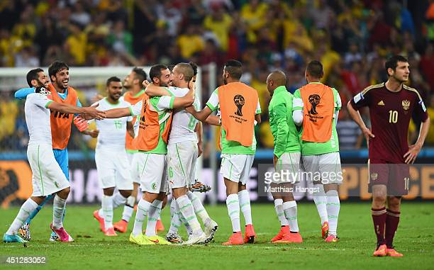 Algeria celebrate after a 11 draw as a dejected Alan Dzagoev of Russia looks on during the 2014 FIFA World Cup Brazil Group H match between Algeria...