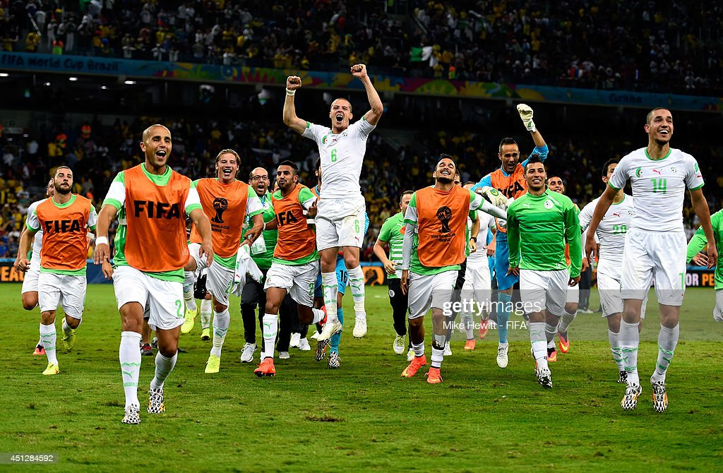Algeria celebrate after a 1-1 draw during the 2014 FIFA World Cup Brazil Group H match between Algeria and Russia at Arena da Baixada on June 26, 2014 in Curitiba, Brazil.