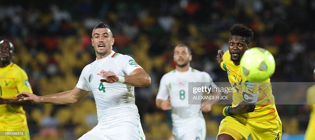 Algeria defender Essaid Belkalem (L) vies with Togo's forward Emmanuel Adebayor during the 2013 African Cup of Nations football match Algeria vs Togo at Royal Bafokeng stadium in Rustenburg on January 26, 2013.