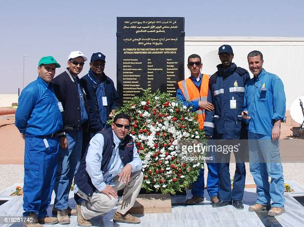 IN AMENAS Algeria Employees of a gas facility in In Amenas eastern Algeria on Feb 24 pose in front of a monument for the victims of a hostage crisis...