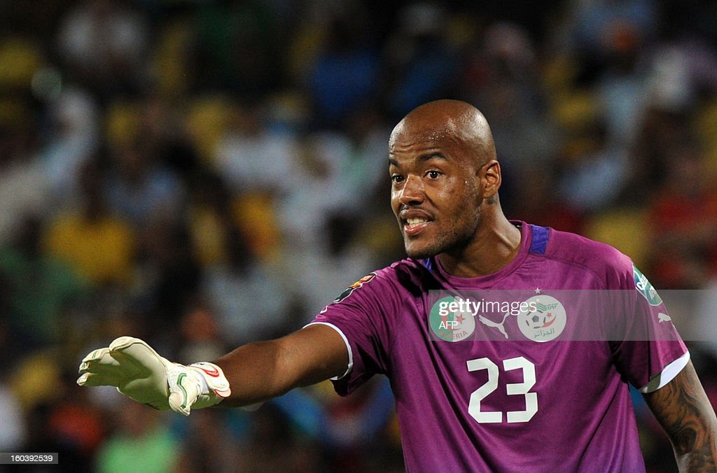 Algeria goalkeeper Rais Mbolhi reacts after Ivory Coast forward <a gi-track='captionPersonalityLinkClicked' href=/galleries/search?phrase=Wilfried+Bony&family=editorial&specificpeople=4231248 ng-click='$event.stopPropagation()'>Wilfried Bony</a> (unseen) scores a goal during the 2013 African Cup of Nations Group D football match between Algeria and Ivory Coast in Rustenburg on January 30, 2013, at the Royal Bafokeng stadium.