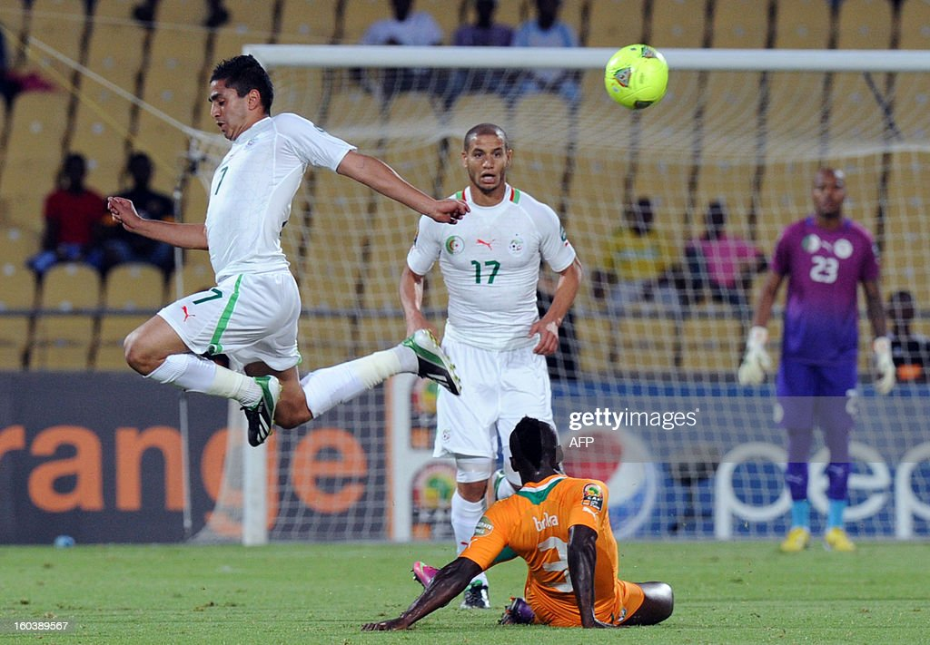 Algeria midfielder Ryad Boudebouz vies with Ivory Coast defender Arthur Boka during a 2013 African Cup of Nations Group D match in Rustenburg on January 30, 2013 at Royal Bafokeng Stadium.