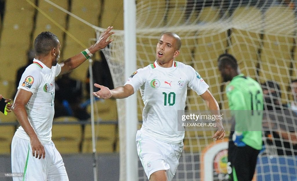 Algeria midfielder Sofiane Feghouli (R) celebrates after scoring a goal against Ivory Coast on January 30, 2013 during a 2013 African Cup of Nations Group D football match at the Royal Bafokeng stadium in Rustenburg. JOE