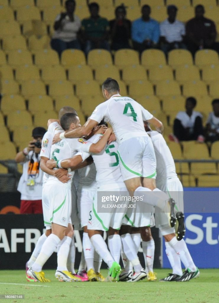 Algeria midfielder Sofiane Feghouli celebrates with teammates after scoring a goal against Ivory Coast on January 30, 2013 during a 2013 African Cup of Nations Group D football match at the Royal Bafokeng stadium in Rustenburg. JOE