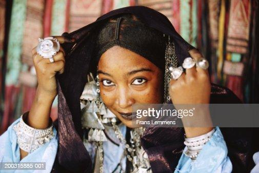 Algeria, near Tamanrasset, Tuareg woman dressed for festival, portrait