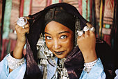 Algeria, near Tamanrasset, Tuareg woman dressed for festival, portrait