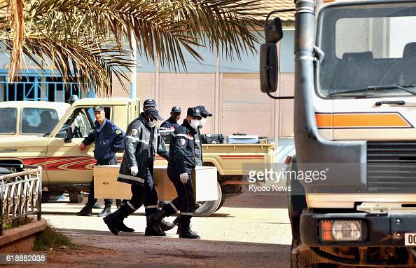 IN AMENAS Algeria Paramedics carry a coffin into a hospital in In Amenas Algeria on Jan 21 where the bodies of some of the victims of a hostage...