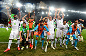 Algeria players and team staffs celebrate qualifying for the knock out stage after the 11 draw in the 2014 FIFA World Cup Brazil Group H match...