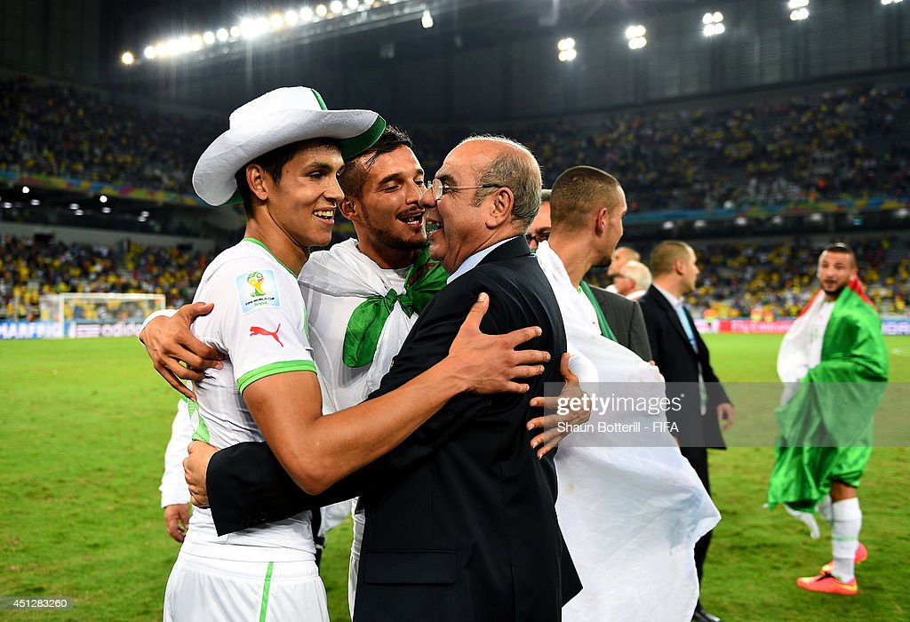 Algeria players and team staffs celebrate qualifying for the knock out stage after the 1-1 draw in the 2014 FIFA World Cup Brazil Group H match between Algeria and Russia at Arena da Baixada on June 26, 2014 in Curitiba, Brazil.