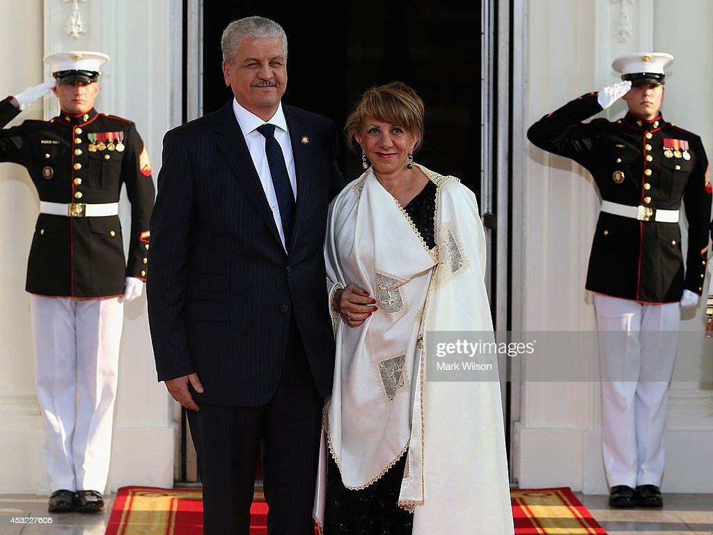 Algeria Prime Minister <a gi-track='captionPersonalityLinkClicked' href=/galleries/search?phrase=Abdelmalek+Sellal&family=editorial&specificpeople=3196882 ng-click='$event.stopPropagation()'>Abdelmalek Sellal</a> and spouse Farida Sellal arrive at the North Portico of the White House for a State Dinner on the occasion of the U.S. Africa Leaders Summit, August 5, 2014 in Washington, DC. African leaders are attending a three-day-long summit in Washington to strengthen ties between the United States and African nations.