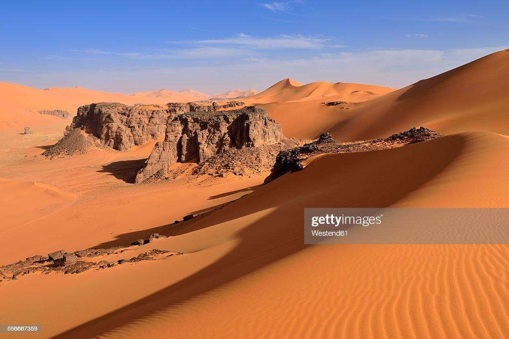 Algeria, Sahara desert, sand dunes and rock towers at Ouan Zaouatan
