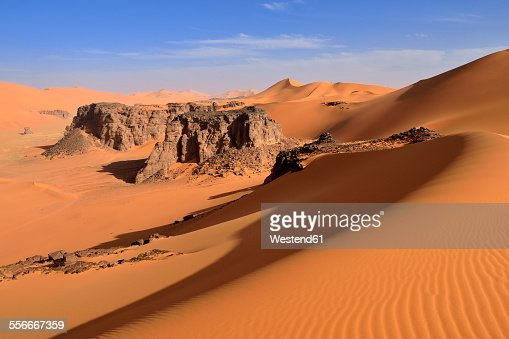 Algeria, Sahara desert, sand dunes and rock towers at Ouan Zaouatan