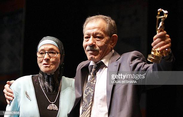 Algerian acters Shadia Abu Thraa and Algerian Ahmed benaissa take the Golden Award for their movie 'Kharejun ann alQanon' during the final day of the...