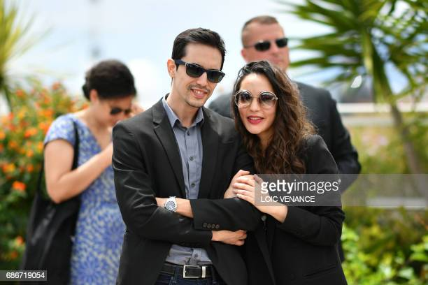 Algerian actor Mehdi Ramdani and Algerian actress Hania Amar arrive on May 22 2017 during a photocall for the film 'Until the Birds Return' at the...