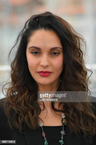 Algerian actress Hania Amar poses on May 22 2017 during a photocall for the film 'Until the Birds Return' at the 70th edition of the Cannes Film...