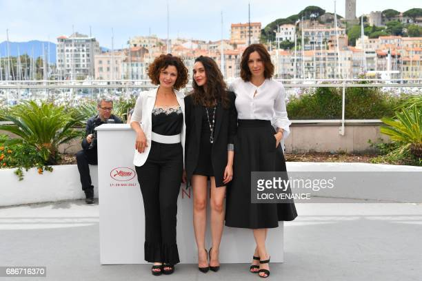 Algerian actress Nadia Kaci Algerian actress Hania Amar and French actress Aure Atika pose on May 22 2017 during a photocall for the film 'Until the...