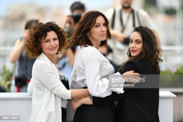 Algerian actress Nadia Kaci French actress Aure Atika and Algerian actress Hania Amar pose on May 22 2017 during a photocall for the film 'Until the...