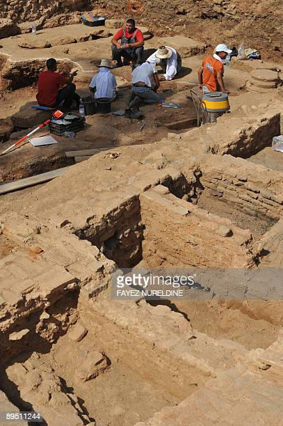Algerian archeologists work on July 27 2009 in the Casbah the historical neighborhood of the capital Algiers which was named a world heritage site by...