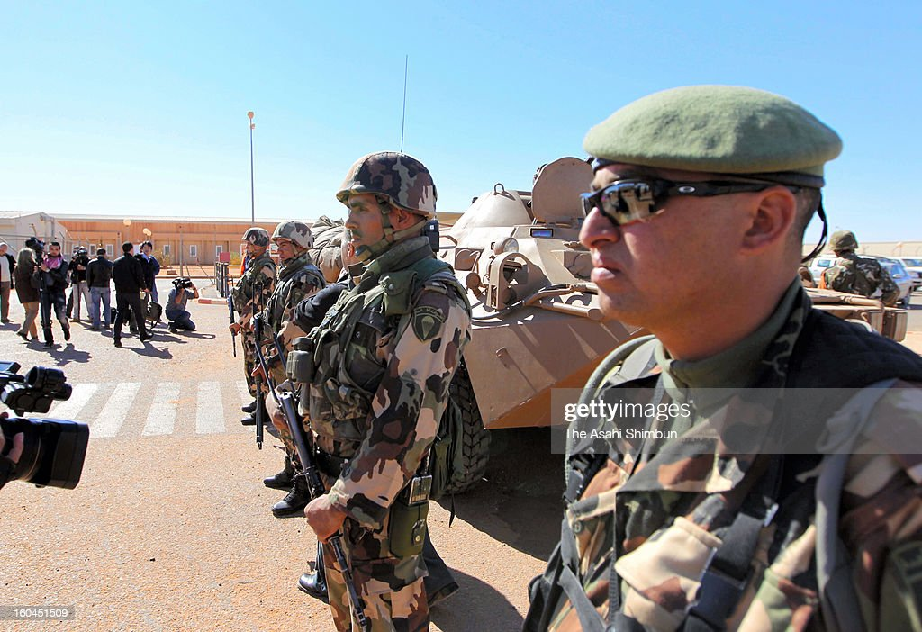 Algerian Army soldiers stand guard at the enterance gate of the residential area on January 31, 2013 in In Amenas, Algeria. Thirty-seven foreign hostages including 10 Japanese and 29 Islamic militants died.
