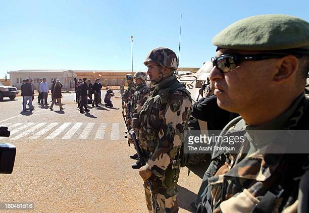 Algerian Army soldiers stand guard at the enterance gate of the residential area on January 31 2013 in In Amenas Algeria Thirtyseven foreign hostages...