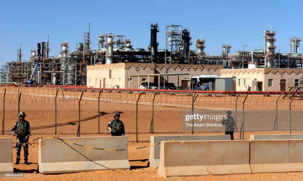 Algerian Army soldiers stand guard at the natural gas plant, recent hostage crisis site, on January 31, 2013 in In Amenas, Algeria. Thirty-seven foreign hostages including 10 Japanese and 29 Islamic militants died.