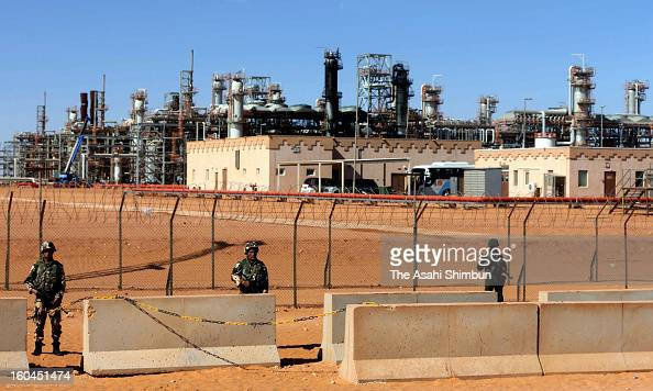 Algerian Army soldiers stand guard at the natural gas plant recent hostage crisis site on January 31 2013 in In Amenas Algeria Thirtyseven foreign...