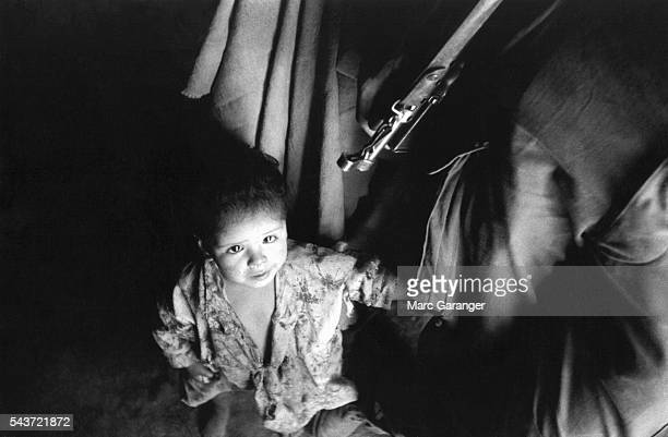 Algerian Child Under Rifle of French Soldier
