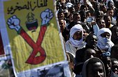 Algerian demonstrators stage a sitin on March 5 2015 at Somoud Square in the Sahara desert village of InSalah south Algeria against the exploration...