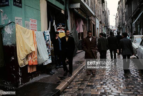 Algerian emigrants in a street of the Arab quarters Marseille 1974